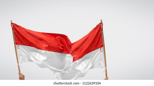 Indonesian independance day  with two flags waving over background.