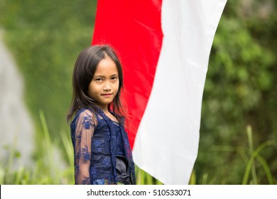 Indonesian Little Girl Poses with Red-White Flag Background