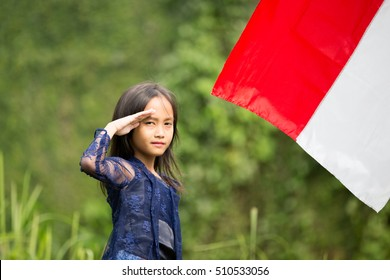 Indonesian Little Girl Salutes The Flag