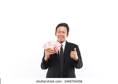 indonesian man isolated smart holding money