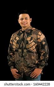 Indonesian man on batik, isolated on black