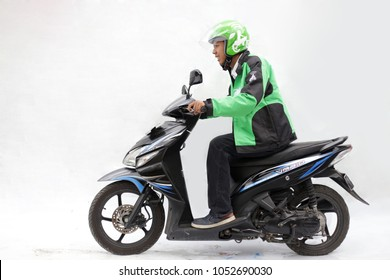 indonesian man using motorcycle for taxi online is name gojek, grab and uber. march 19, 2018. Yogyakarta Indonesia.