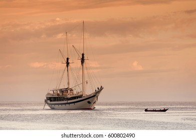 Indonesian Phinisi Schooner at Sunset. A traditional Phinisi schooner anchored off Waigeo Island in the Raja Ampat  area of West Papua, Indonesia.