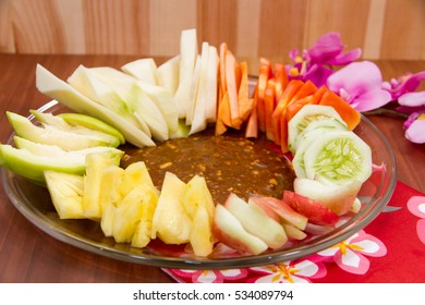 Indonesian Rujak, Indonesian Mix Fruits, served on transparent plate on wooden background