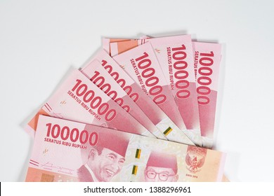 Indonesian rupiah currency notes in one hundred thousand denomination isolated against white background