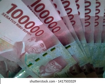 Indonesian rupiah, front side shows the face of the late former Indonesian first president and vice president Ir.Soekarno & M.Hatta.100000 seratus ribu rupiah means one hundred thousand rupiahs