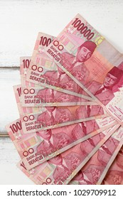 Indonesian rupiah money isolated on wood background, hundred thousand Indonesia Rupiah