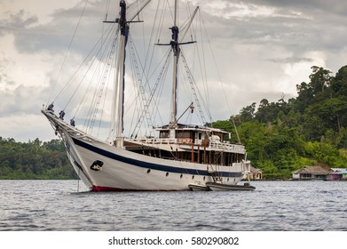 Indonesian Schooner anchored in Raja Ampat, Misool Island, West Papua. A traditional phinisi schooner is anchored off Aduwey Village in the Raja Ampat area of Indonesia.