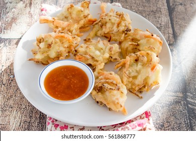 Indonesian Snack Bakwan ,vegetables fritter served with chili sauce, selective focus