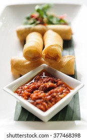 Indonesian spring rolls, or lumpia, served with sambal, Ubud, Bali, Indonesia.