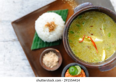 Indonesian style chicken soup served with rice and sambal.