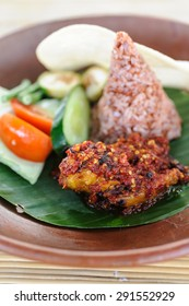 Indonesian style grilled chicken served with sambal, rice and vegetables.