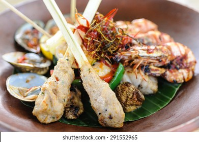 Indonesian style seafood with fish sate, grilled prawns and shellfish.