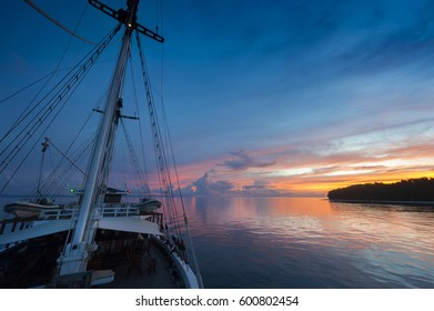 Indonesian Sunset from  a Schooner Sailboat. Sailing through the Raja Ampat archipelago on a traditional phinisi schooner during a glorious sunset.
