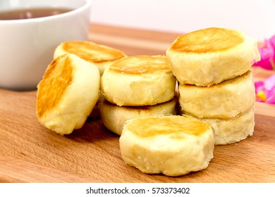 indonesian traditional cake, pia butter scotch served on wooden plate