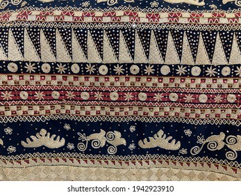 Indonesian traditional fabric from Lampung, called Tapis, with gold, red and black thread decoration motifs.