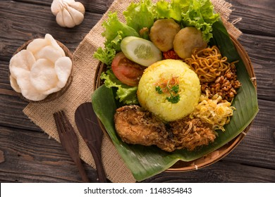 indonesian traditional yellow rice served with banana leaf plate