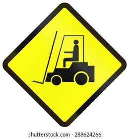 Indonesian warning road sign - forklift trucks on the road.