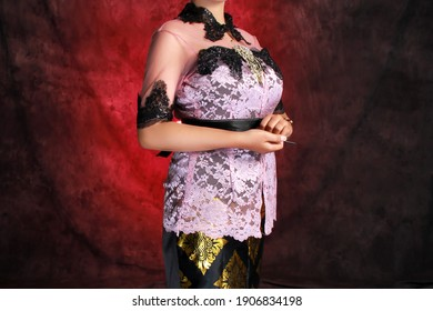 Indonesian women's kebaya with a modern style. Kebaya is a typical Javanese clothing with a batik motif. fashion portraits of women for festivals, formal wear or weddings