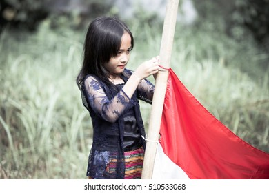 Indonesian Young Girl Fix Her Red-White Flag's Halyard