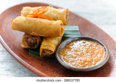 Indonesian-style spring rolls served with sambal dipping sauce and red chillies.