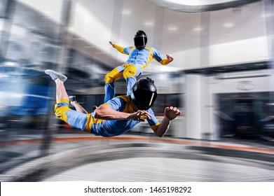 Indoor Adventure activity fly in Dubai. Indoor sky diving trick. Action fly adrenaline sport activity in wind tunnel