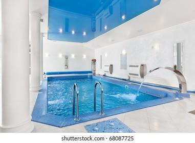 Indoor big blue swimming pool interior in modern minimalism style