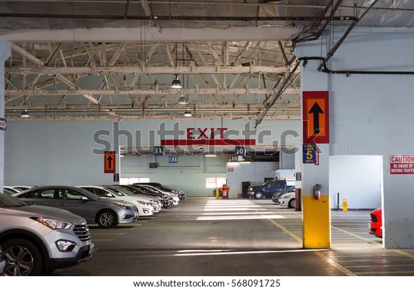 Indoor car parking/garage with exit sign