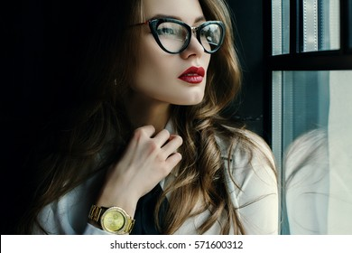 6b026d6649c1 Indoor close up portrait of beautiful fashionable business woman posing in  loft interior. Model looking