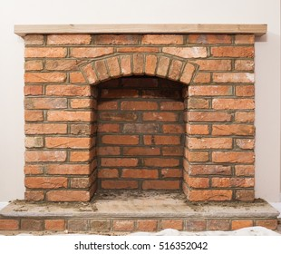 Indoor DIY project: building fireplace in the house: finishing touches, selective focus