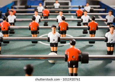 Indoor foosball table with white team vs. red team.