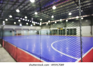 indoor football court.  intentional out of focus camera technique used.