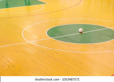 Indoor football or futsal stadium with a bright markup of the playing field and ball in center. Soccer playground. Top View.