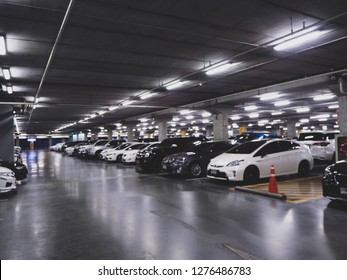 indoor full modern parking lot in supermarket