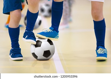 Indoor futsal soccer players playing futsal match. Indoor soccer sports hall. Futsal players kicking match. Soccer training dribbling drill. Sports background. Futsal league.