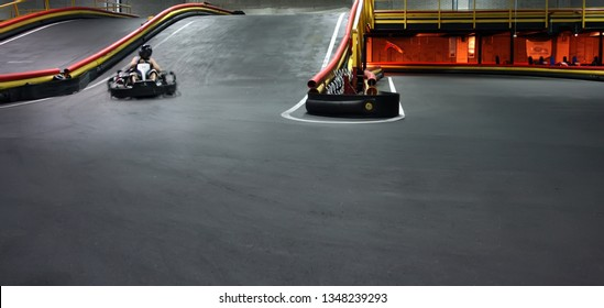 Indoor kart racing on the go kart track. panorama
