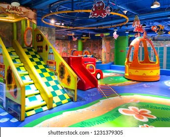 Indoor modern colorful children playground. Inside kids playground with slides. Kids entertainment and recreation. 11/12/2018