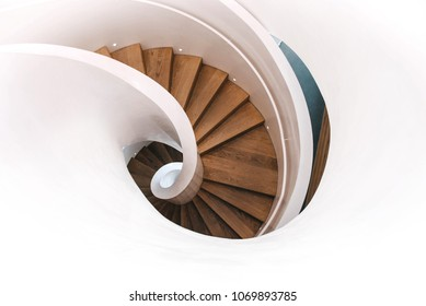 Indoor modern spiral staircase in white. Top view.