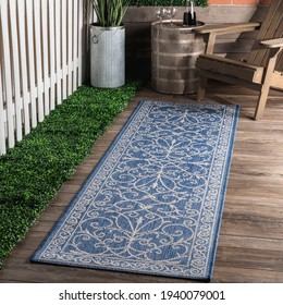 Indoor Outdoor Floral Polyester Area Rug.