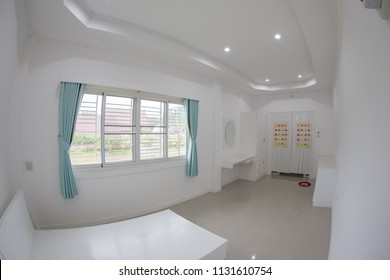 Indoor panoramic or fisheye lens view showing little white pre - decoration environmental bedroom on the upstairs of a private residential house
