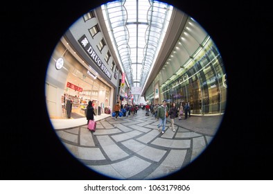 Indoor panoramic scenic view in Shinsaibashi walking street, one of famous shopping site in Osaka, Japan in March 18  2018. Visiting tourists walking back & forth surrounding by luxurious stores.