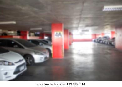 Indoor parking lot building blurred background.