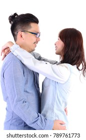 indoor portrait of asian couple isolated over white background