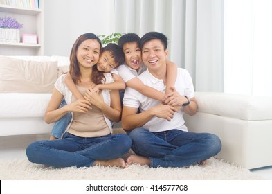 Indoor portrait of asian mixed race family