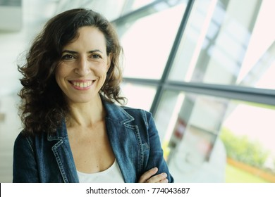 Indoor portrait of beautiful 40 years old woman