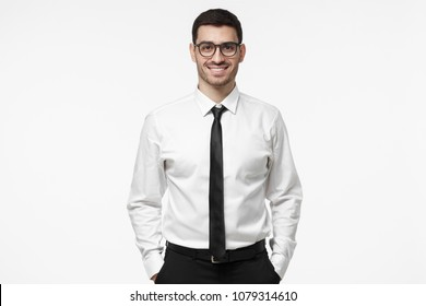 a90b21529 Indoor portrait of handsome European businessman pictured isolated on white  background dressed in white formal shirt