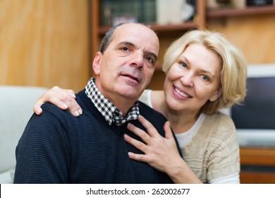 Indoor portrait of loving mature couple