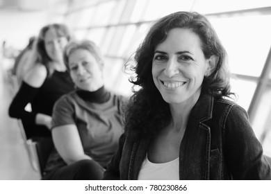 Indoor portrait of three beautiful 40 years old woman