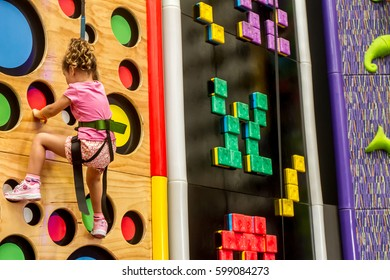 indoor portrait of a young child climbing up
