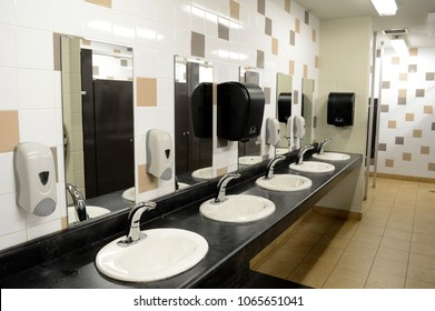 Indoor public washroom view of the sink areas.